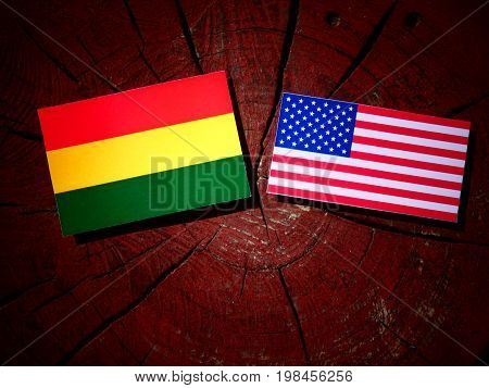 Bolivian Flag With Usa Flag On A Tree Stump Isolated