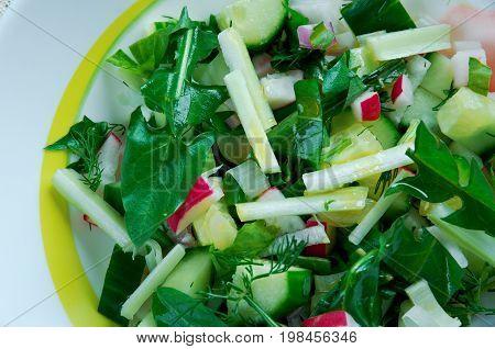 Traditional Slavic spring salad of dandelions , close up meal