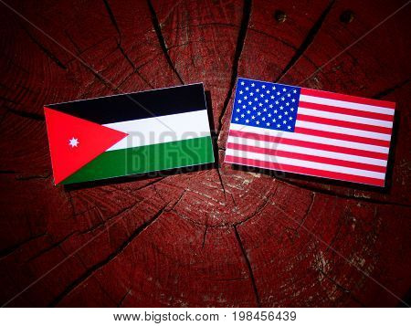 Jordanian Flag With Usa Flag On A Tree Stump Isolated