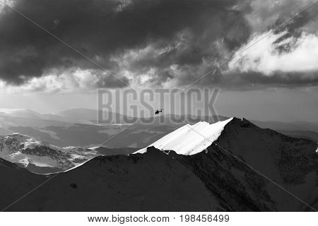 Black And White View On Off-piste Slope For Heliskiing And Helicopter In Evening