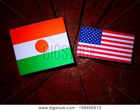 Niger Flag With Usa Flag On A Tree Stump Isolated