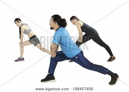 Multicultural of young friends doing stretching exercise together isolated on white background