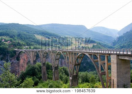 An old bridge over the Tara river. The bridge was built in the last century around 1937. With its imposing 170 meters high