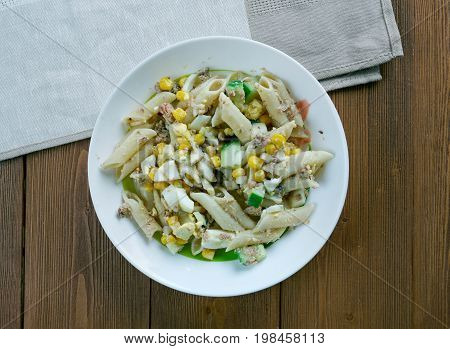 Salad with pasta sardines and vegetables freshness cooked close up