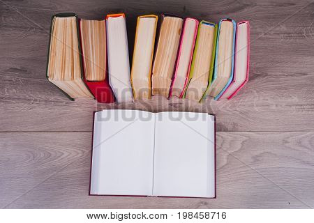 Open Book, Hardback Bookson Wooden Background. Back To School. Top View. Copy Space For Text