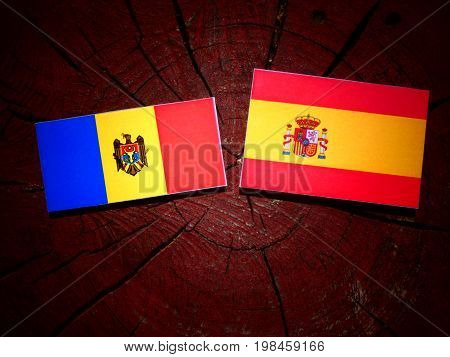Moldovan Flag With Spanish Flag On A Tree Stump Isolated