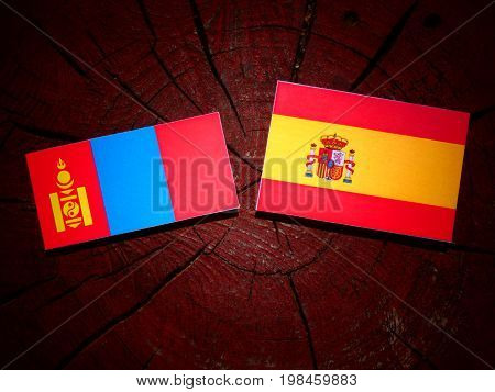 Mongolian Flag With Spanish Flag On A Tree Stump Isolated