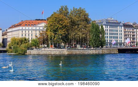 Geneva, Switzerland - 24 September, 2016: the Rhone river and buildings along it in the city of Geneva. The city of Geneva is the capital of the Republic and canton of Geneva, being the second most populous city in Switzerland.