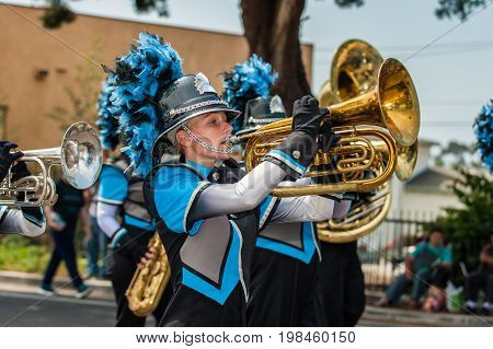 Marching band female baritone player in the number one position.
