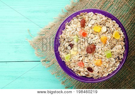 Oatmeal With With  Dried Fruit(strawberries, Grapes, Kiwi, Peach). Oatmeal On A Wooden Table. Oatmea