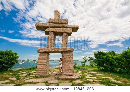 Toronto, Ontario, Canada, June 16, 2017 gorgeous amazing, inviting view of Toronto down town area outdoor park with natural landscape view and stunning inuksuk sculpture on dark blue sky background