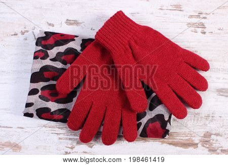 Pair Of Woolen Gloves And Shawl For Woman On Old Board