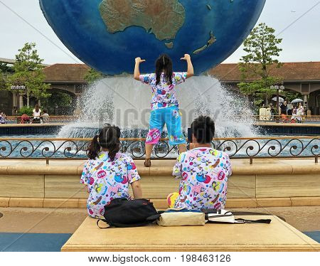 TOKYO JAPAN - JULY 23 2017: Two girls and one boy dressed in the same clothes a Japanese fashion trend where friends wear the same clothes or couples wear matching clothes.