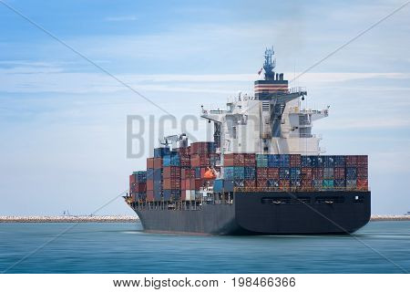Logistics and transportation of Container Cargo ship and Cargo plane with working crane bridge in shipyard at Twilight sky logistic import export background and transport industry.