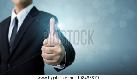 Businessman showing OK or hand sign thumb up The excellence of the business or service concept Copy space