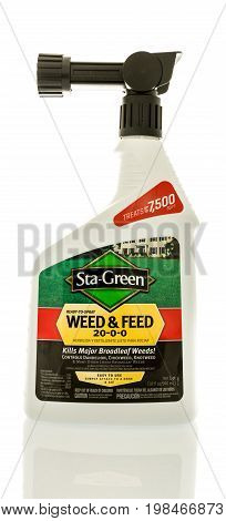Winneconne WI - 5 August 2017: A bottle Sta-Green weed and feed on an isolated background.