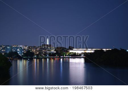 Panoramic photo of Washington, D.C. skyline at night.