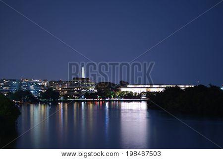 Panoramic photo of Washington, D.C. skyline at night.