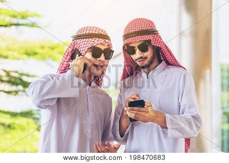 Arab Men Talking And Using Mobile Phone