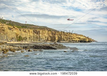 Us Coastguard Helicopter In Flight Point Loma Beach