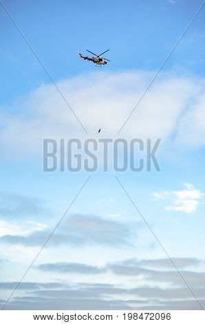 Us Coastguard Helicopter In Flight With The Sky In The Background