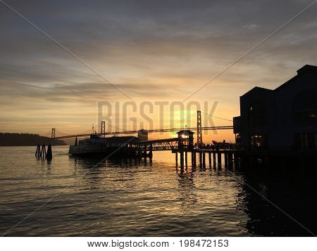 A San Francisco Pier and Bay Bridge at Dawn