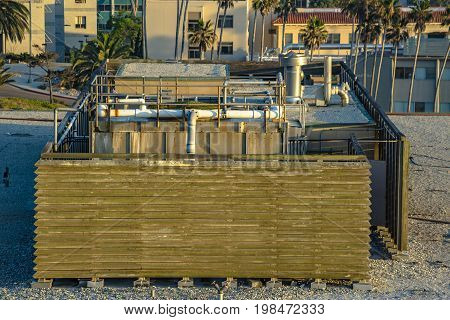 Utility Pipes And Appliances On The Rooftop Of A Business Building