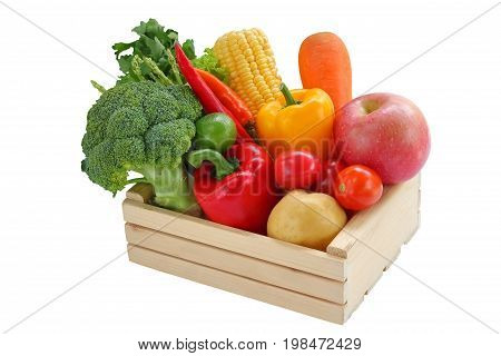 Fresh vegetable mixed in the box wood on isolate background.