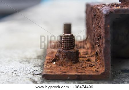 Corrosive rusted bolt with nut. Grunge industrial construction close up