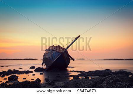 Shipwreck in Angsila Chonburi with beach sunset