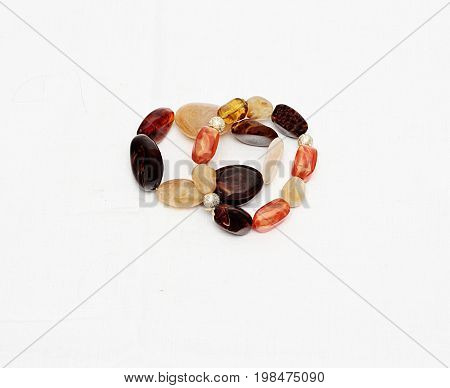Two female bracelets from semi-precious stones isolated against white background.