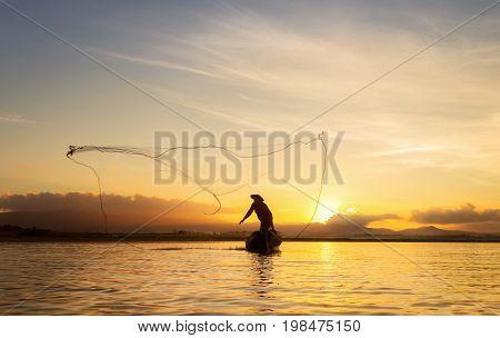 Fisherman of Bangpra Lake in action when fishing Thailand.