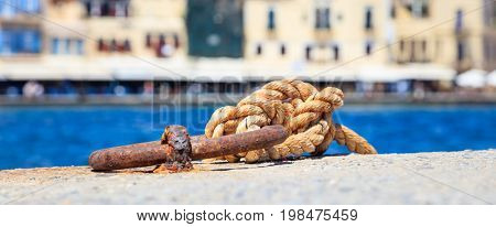 Bollard and rope on a quayside - Greece, Chania port
