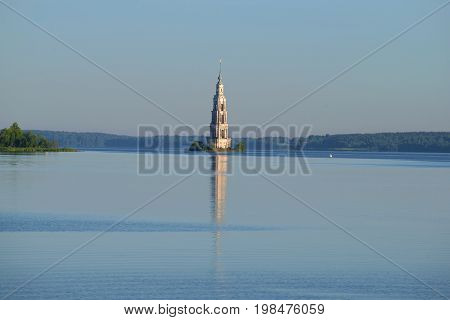 Early July morning on the Uglich reservoir. View of the flooded belfry of St. Nicholas Cathedral. Kalyazin, Russia