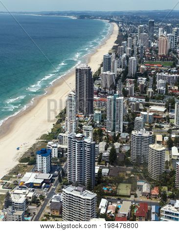 View of the Gold Coast south towards Burleigh Heads. The Gold Coast is one of Australia's most popular tourist destinations with beautiful beaches. Beach front highrise accommodation and apartments can be seen in close proximity to the beach.