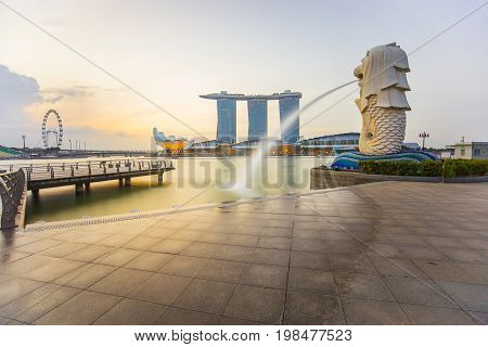 The Merlion With Sunrise In City Center Of Singapore