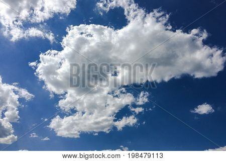Isolated white cloud on blue sky. Beautiful blue sky with clouds background. Sky with clouds weather nature cloud blue. Blue sky with cloud and sun.
