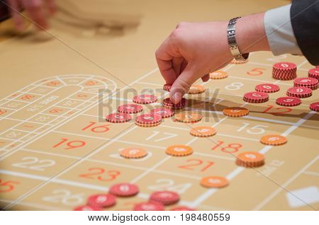Placing roulette chips color image selective focus horizontal image