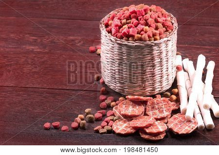 Dog snack ,dog dood, dog chews, dog biscuits on a grey wooden table wall background with copy space .