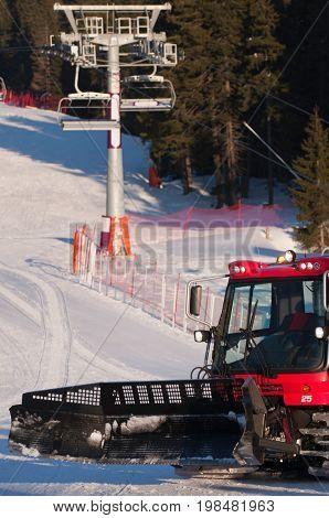 Snowcat On A Ski Slope, Color Image, Selective Focus, Vertical Image