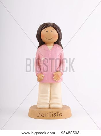 Dentist collection figure with white background and wooden base