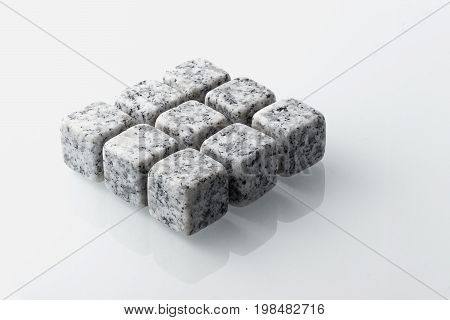 Set of nine spirit chilling stones. Soapstone rocks are carved in cubes to be used as drink chiller (whisky bourbon ...) Various type of raw minerals produces different colors such as marbled grey.