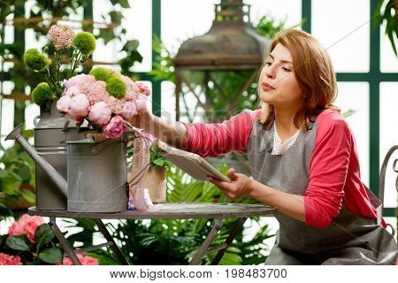 Model with tablet with flowers