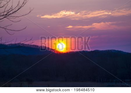 Sunrise in the summer morning over the hills in Primorye.
