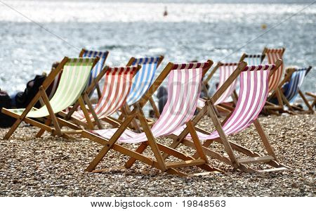 Deck chairs on Brighton beach, UK