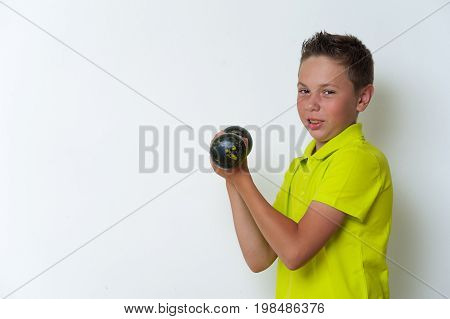 Portrait of tween fit boy posing with dumbbell on white background, copyspace. Healthy lifestyle and fitness