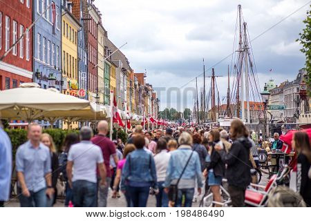 Copenhagen, Denmark - July 08, 2017: Crowd if people at the famous Nyhavn in the city centre