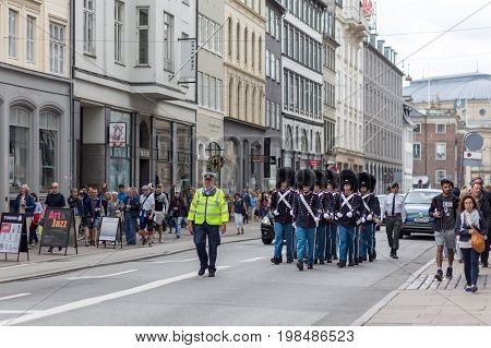 Copenhagen, Denmark - July 08, 2017: Group of Danish Royal Guards on their way to Amalienborg Palace for the change  of guard ceremony