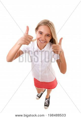 Fun high angle full body portrait of teenage girl shows thumb up gestureisolated on white background