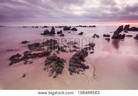 Morning Low tide. Sunrise sand beach near the Noja town Cantabria Northern Spain